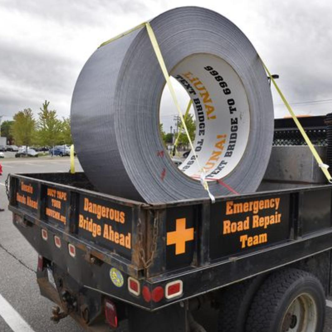 giant roll of tape on truck bed